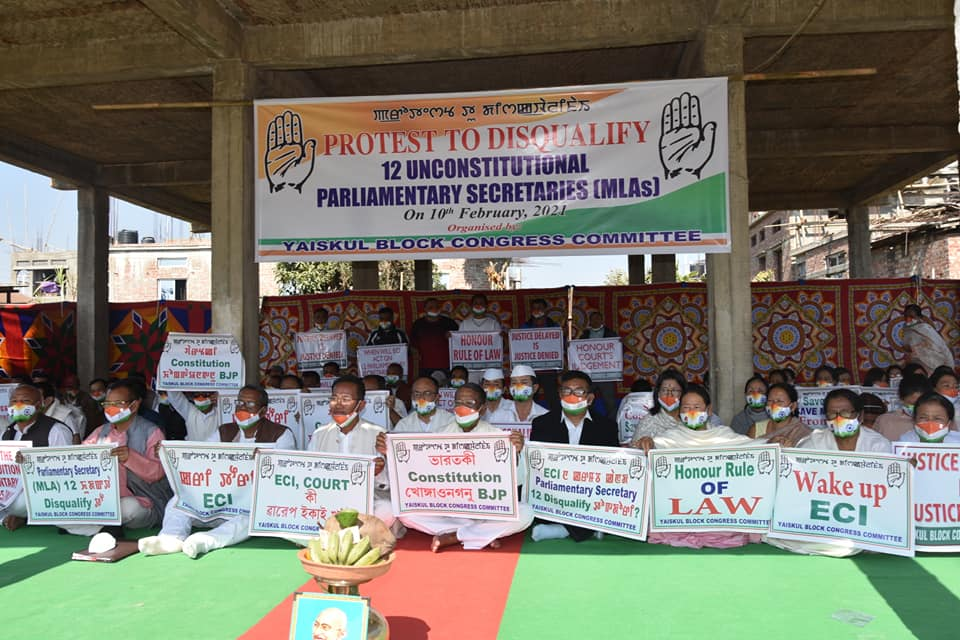Manipur: Congress workers protest demanding disqualification of the 12 MLAs who held  Parliamentary Secretary